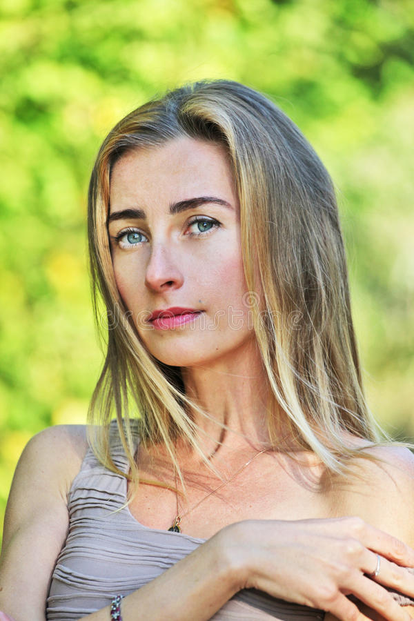 Dark eyebrows for blondes. Beautiful young girl of European appearance whiteskinned, pale with clear wide eyebrows, fashion trend, hair is colored in royalty free stock photo