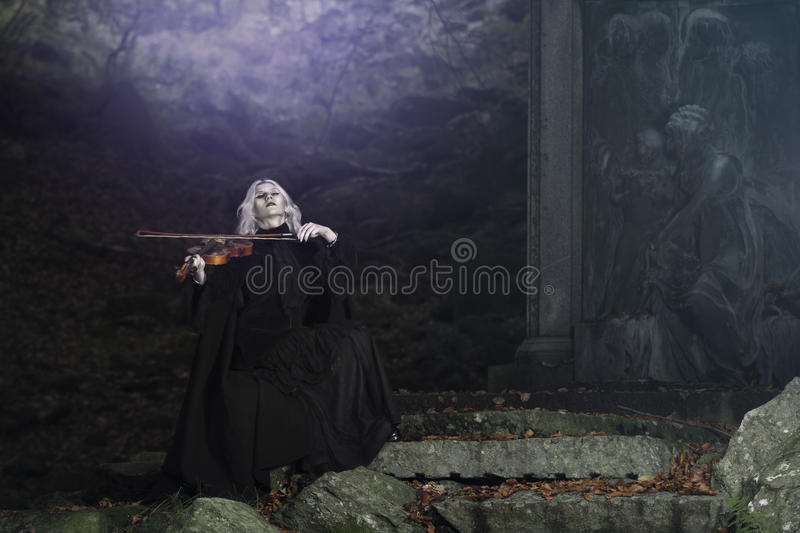 Dark fiddle melody from a vampire stock photos