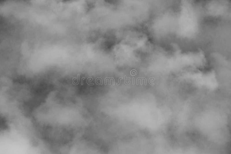 Dark Foggy Clouds Sky. Dense dark gray foggy storm cloud cover early evening sky stock photo