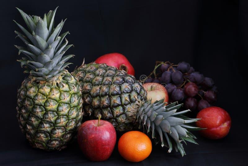 Dark Food - Chiaroscuro fresh fruit stock image