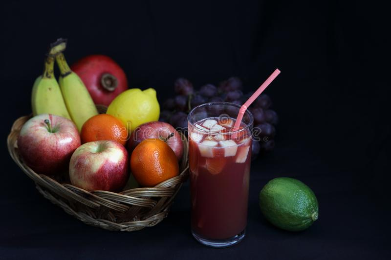 Dark Food - Chiaroscuro mixed fruit in wicker basket royalty free stock photos