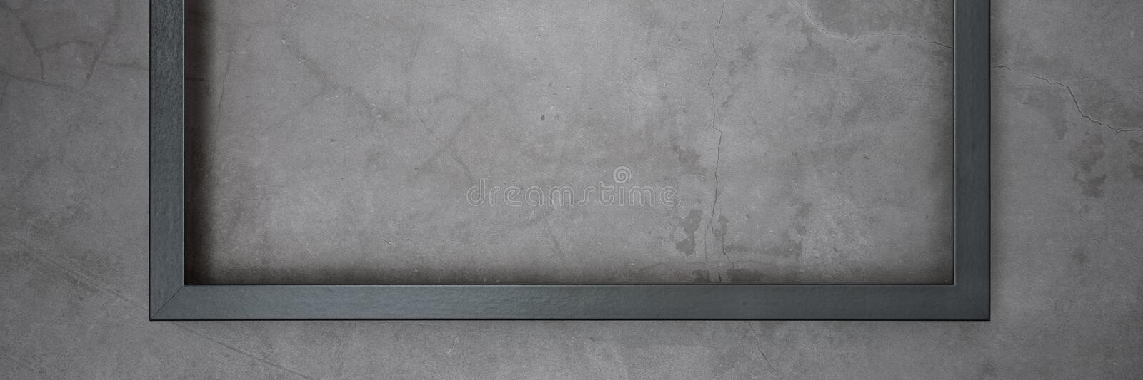 Dark frame for painting on a gray cement textured background royalty free stock image