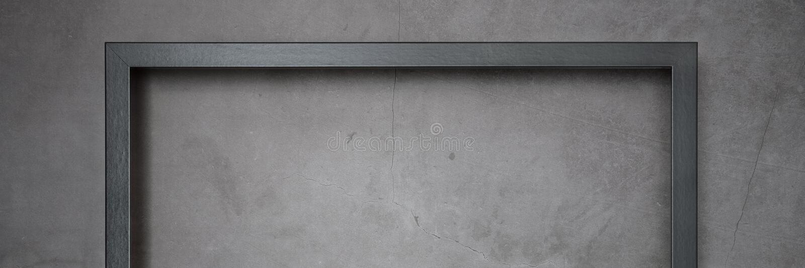 Dark frame for painting on a gray cement textured background. royalty free stock photos