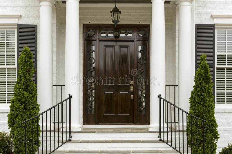 Dark front door with white columns stock photo image