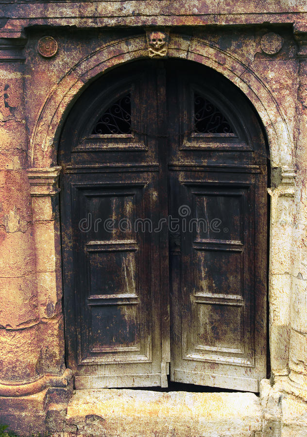 Dark gate. Dark wooden gate with skull symbolizing hell's entrance stock images