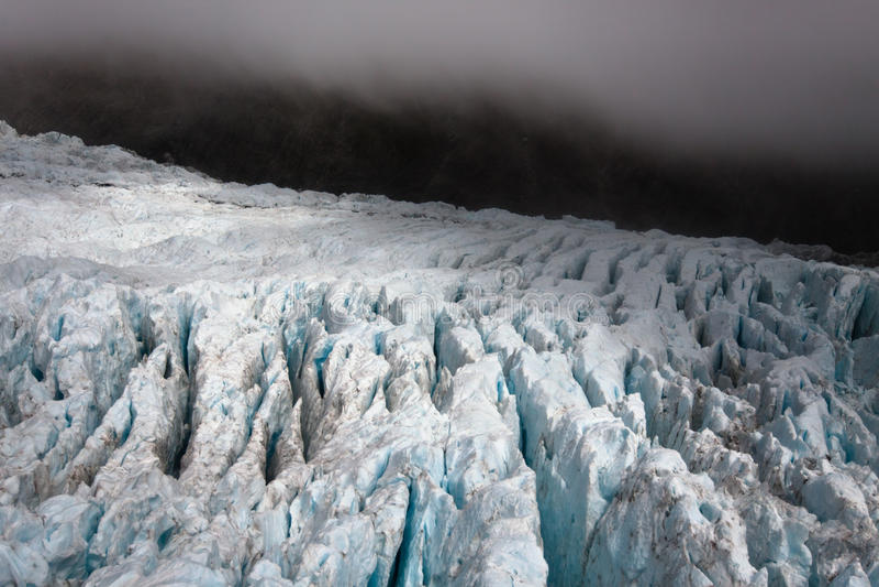 Dark glacier landscape - New Zealand stock photography