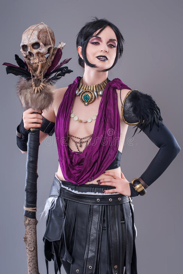 Dark gothic woman. Gothic woman posing with skull stock photo