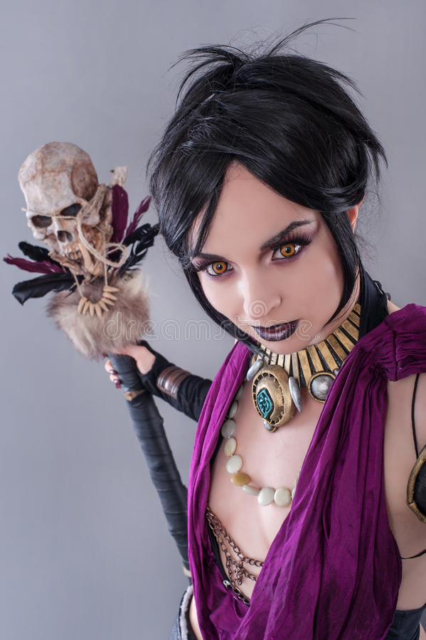 Dark gothic woman. Gothic woman posing with skull stock image