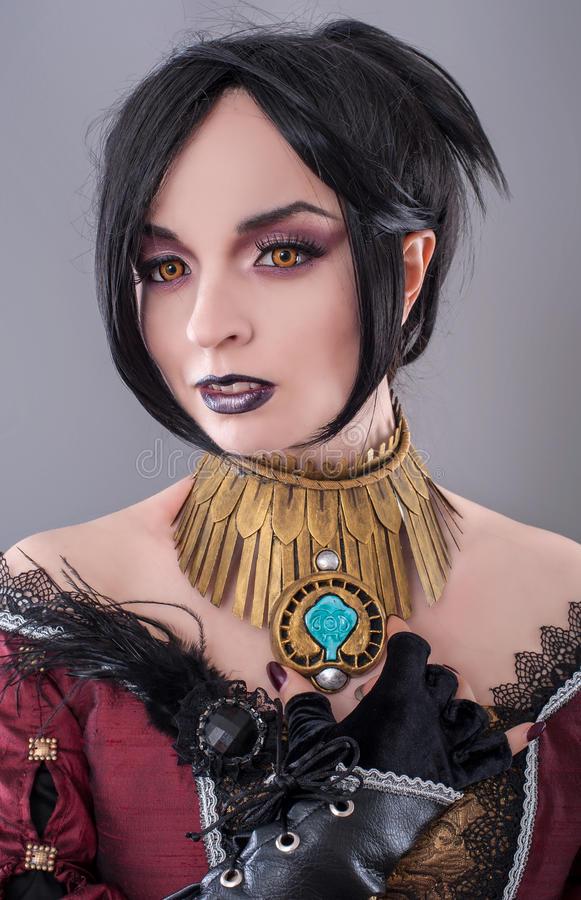 Dark gothic woman. Gothic woman posing in studio royalty free stock photography