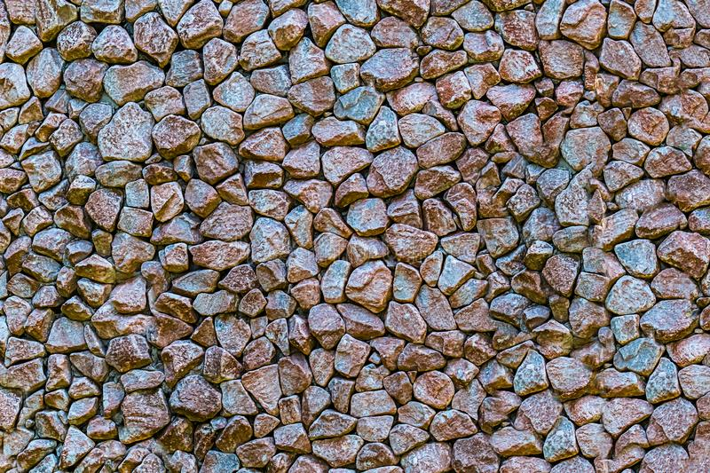 Dark granite stones many small cobblestone background stone backdrop design geology garden decoration royalty free stock photography