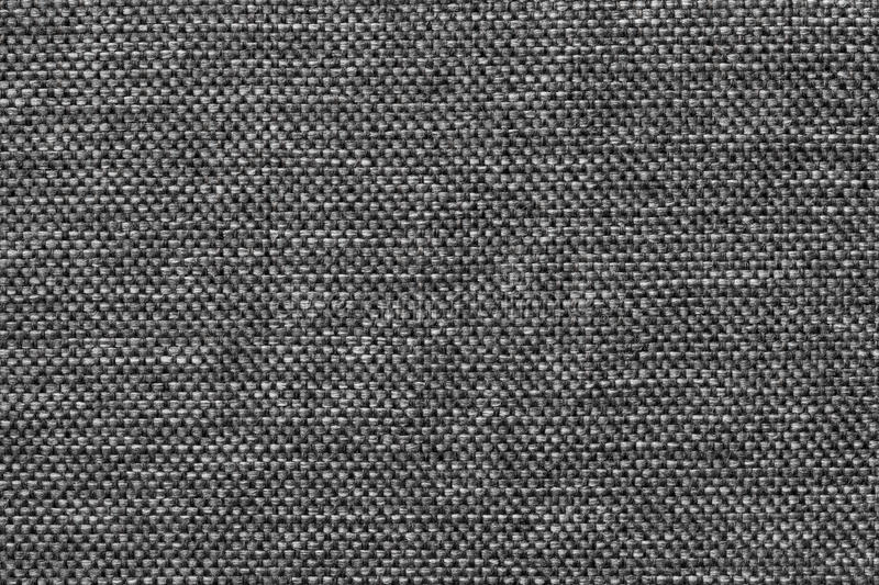 Dark gray background of dense woven bagging fabric, closeup. Structure of the textile macro. stock photography