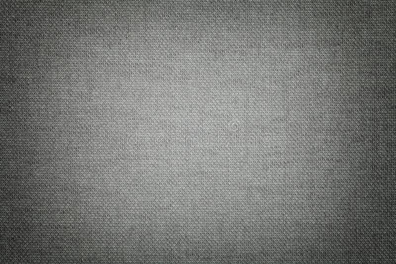 Dark gray background from a textile material with wicker pattern, closeup royalty free stock image