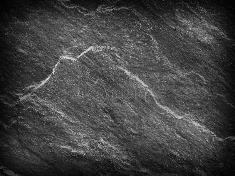 Dark gray black slate stone background or texture and empty space stock photography