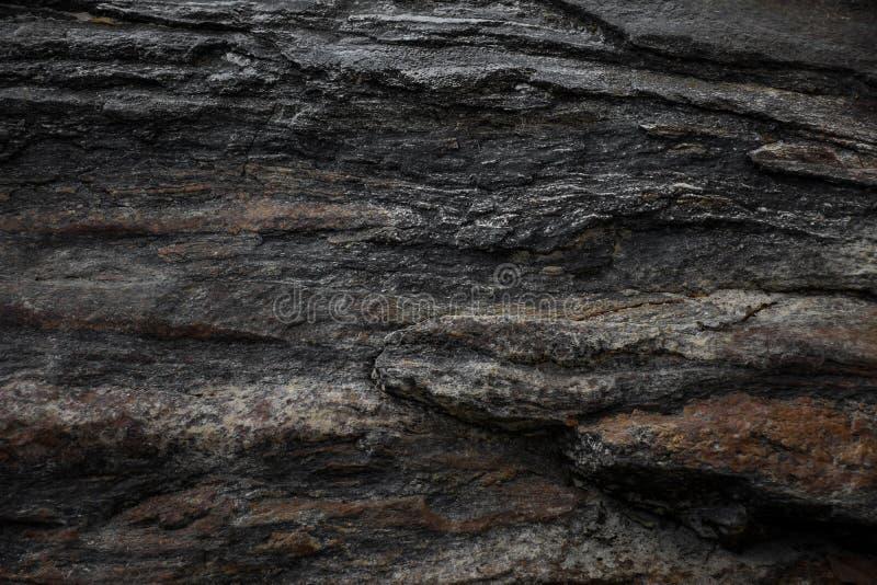Dark gray black slate stone texture background.  royalty free stock images