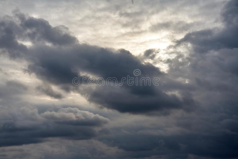 Dark gray dramatic sky. With large clouds stock photography