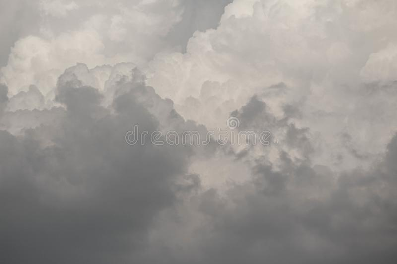 The Dark gray dramatic sky with large clouds in rainy seasons royalty free stock photos