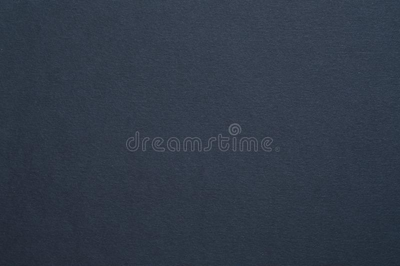 Dark gray felt texture background colored carton. Dark gray felt texture abstract art background. Colored carton surface. Copy space royalty free stock photo