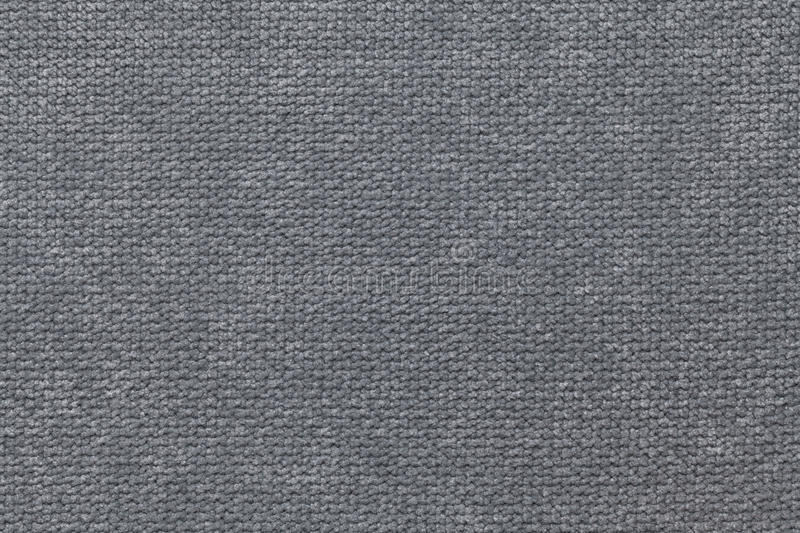 Dark gray fluffy background of soft, fleecy cloth. Texture of textile closeup royalty free stock photo
