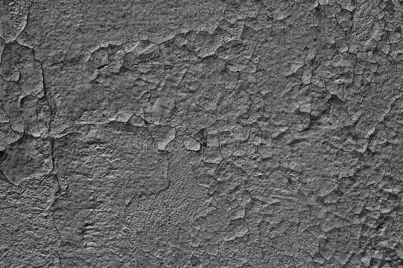 Dark gray grunge background of weathered cracked concrete wall stock image