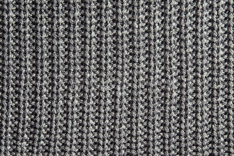 Dark gray knitting texture background or knitted pattern background. royalty free stock image