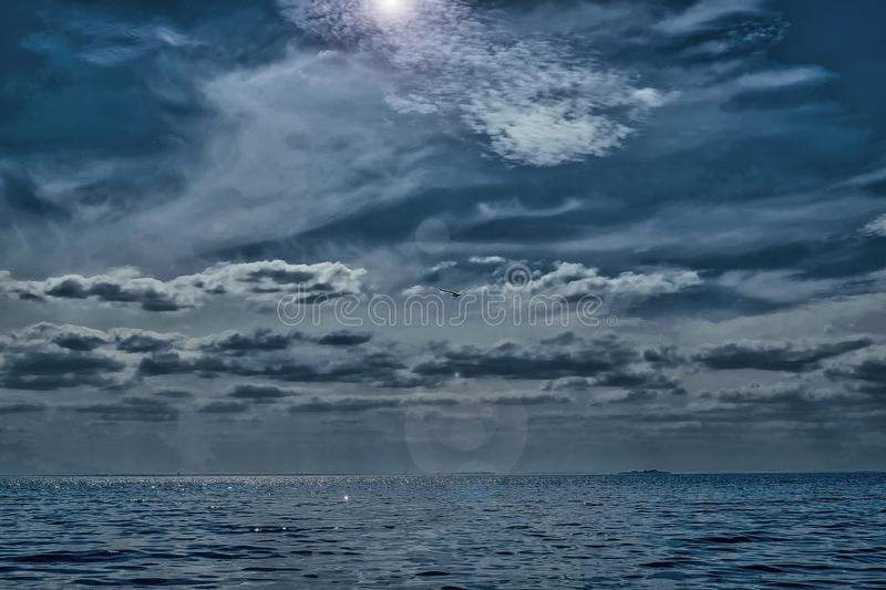 Dark gray sky with clouds, applying filter illusion of bad weather stock photography