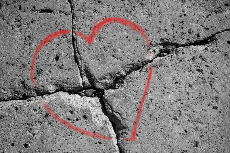 Dark gray stone wall  , inscription marriage broke up. Picture of heart on a cracked stone, gray color, symbolizing the difficulties in marriage and divorce royalty free stock image
