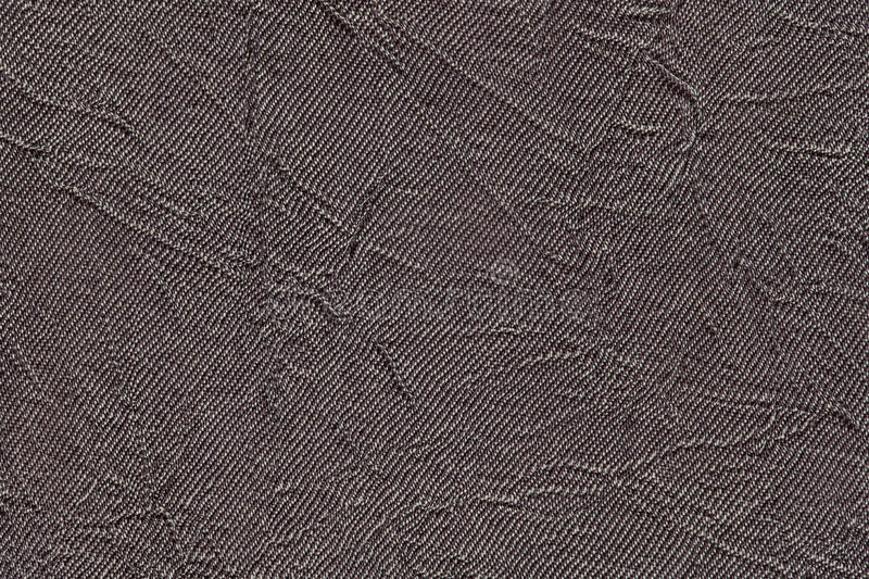 Dark gray wavy background from a textile material. Fabric with fold texture closeup. Creased shiny brown cloth stock photos