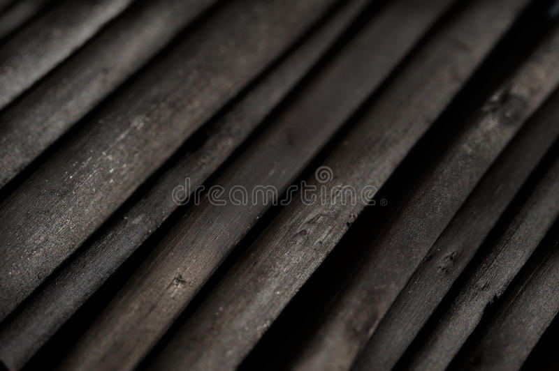Dark gray wooden charcoal texture, close up. royalty free stock image