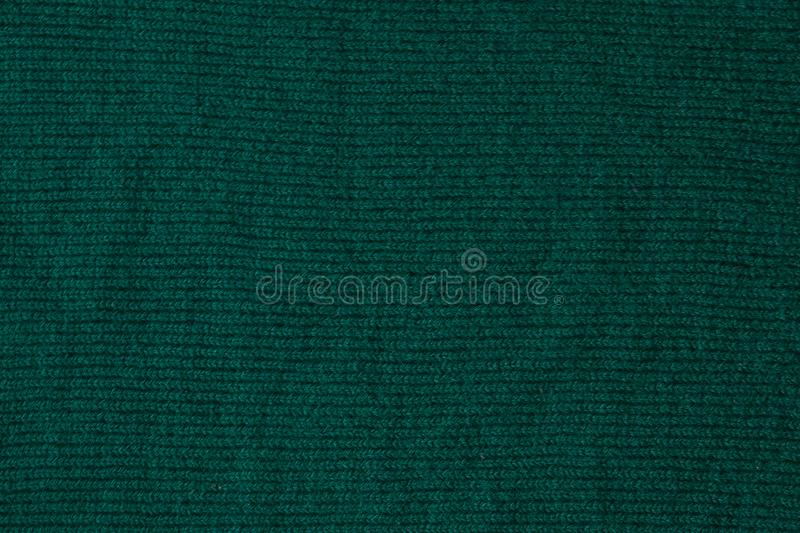 Dark green background from a textile material. Fabric with natural texture. Cloth backdrop.  royalty free stock photo