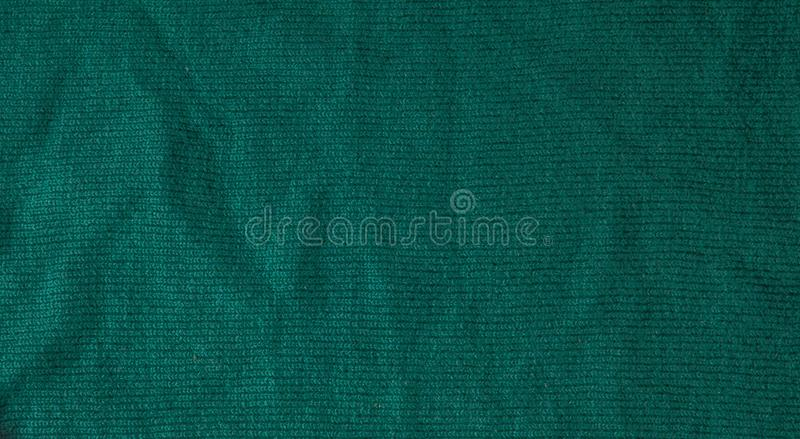 Dark green background from a textile material. Fabric with natural texture. Cloth backdrop.  stock photos