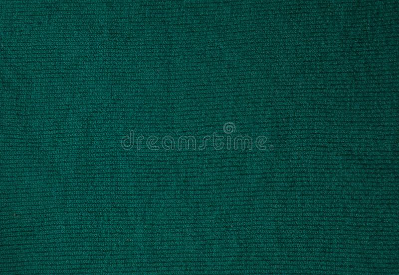 Dark green background from a textile material. Fabric with natural texture. Cloth backdrop.  stock photo