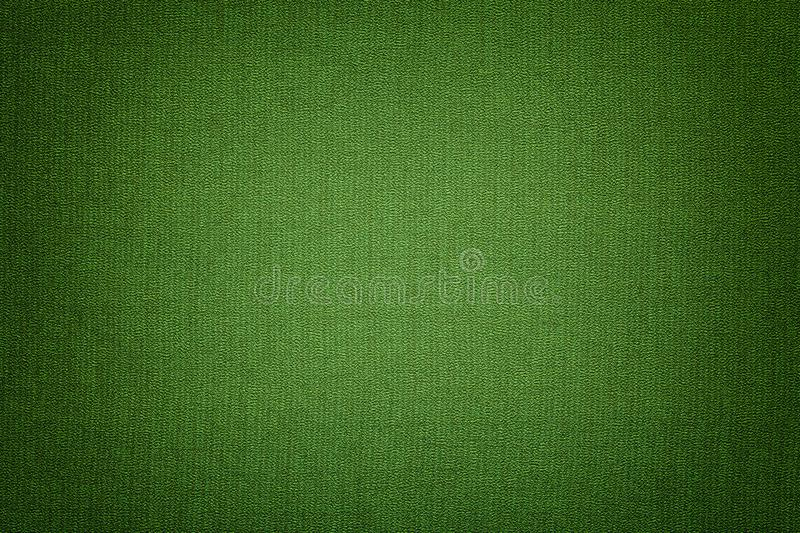 Dark green background from a textile material with wicker pattern, closeup. Structure of the emerald fabric with texture. Cloth backdrop with vignette stock photography