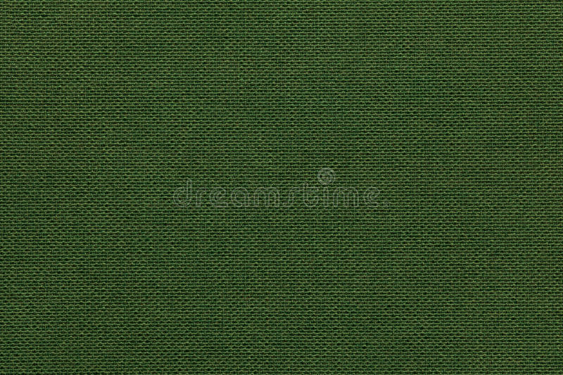 Dark green background from a textile material with wicker pattern, closeup. Structure of the olive fabric with natural texture. Cloth backdrop royalty free stock images