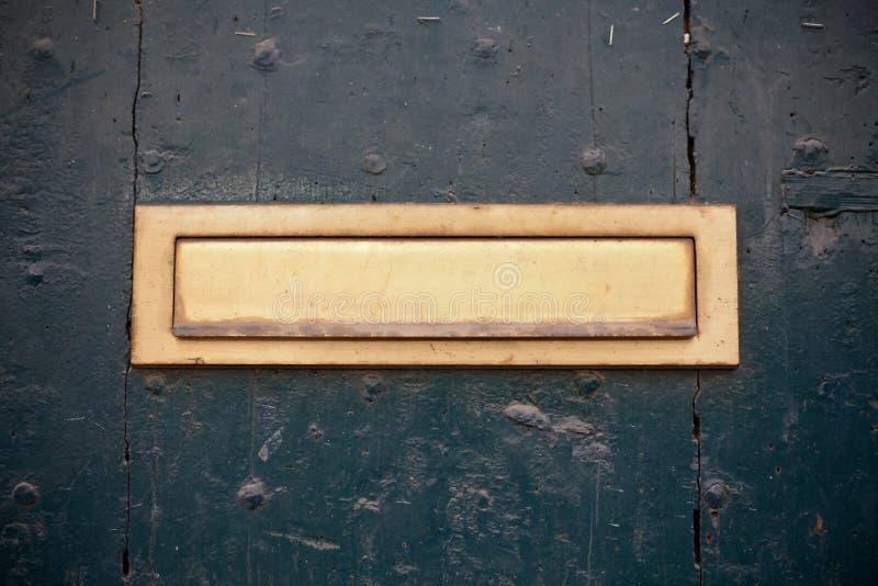 Dark green door with letter slot mailbox. Horizontal shot stock photos