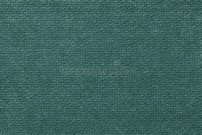 Dark green fluffy background of soft, fleecy cloth. Texture of light nappy textile, closeup. stock images