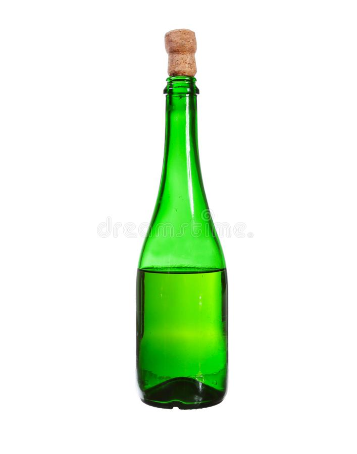 Dark green glass bottle with white wine isolated on a white back. Ground royalty free stock photo
