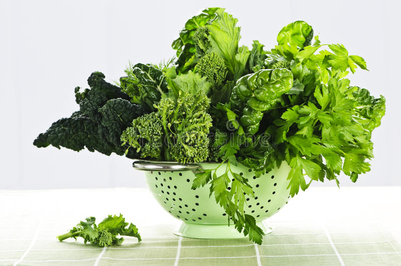 Dark green leafy vegetables in colander royalty free stock photography