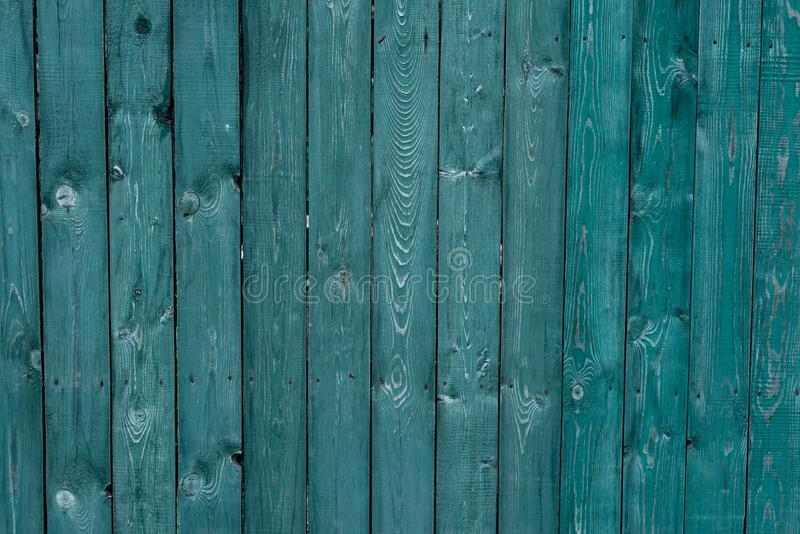 Dark green old wooden boards. Backgrounds and textures fence painted. Front view. Attract beautiful vintage background. royalty free stock photography