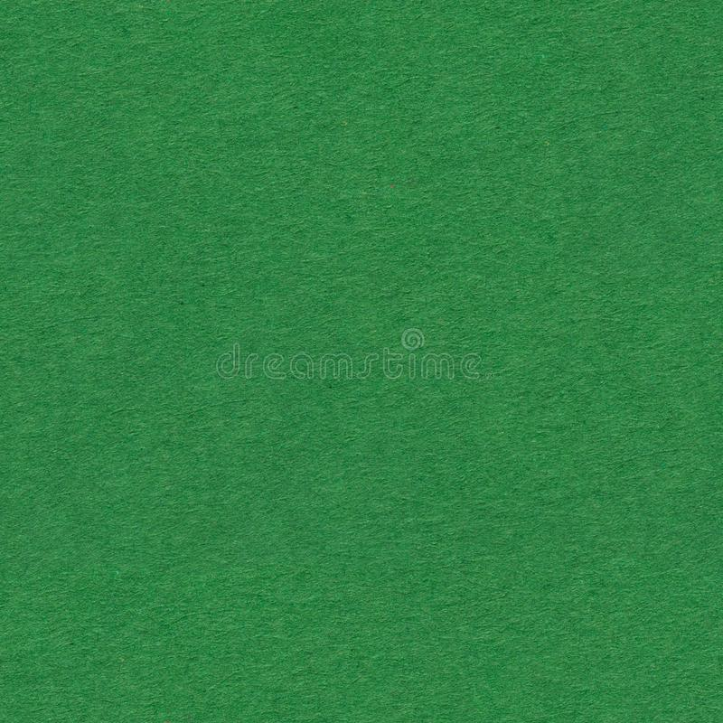 Dark green paper as background. Seamless square texture, tile ready. High quality image royalty free stock photos