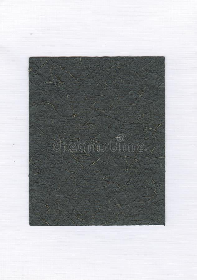Dark green paper on white background, dark green crumpled paper, wrinkled green paper royalty free stock photo