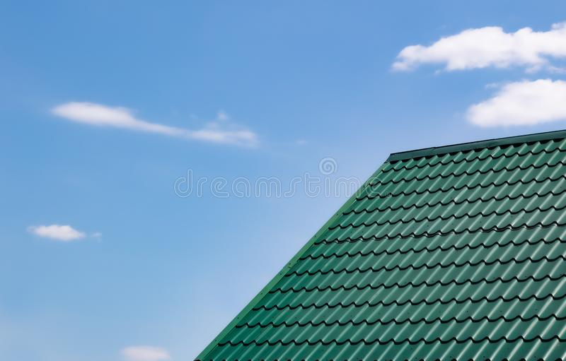 Dark green roof of the house from a metal royalty free stock images