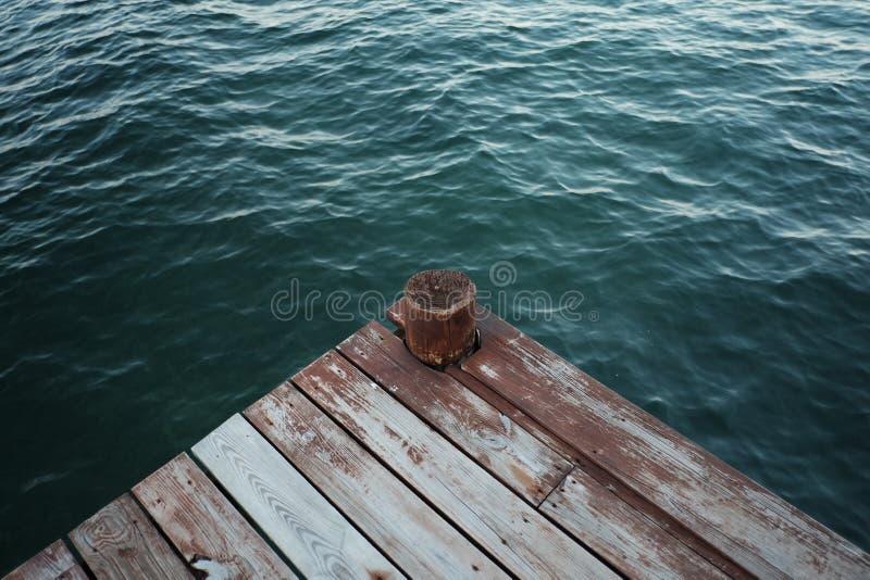Dark Green Sea Water Wooden Pier stock image