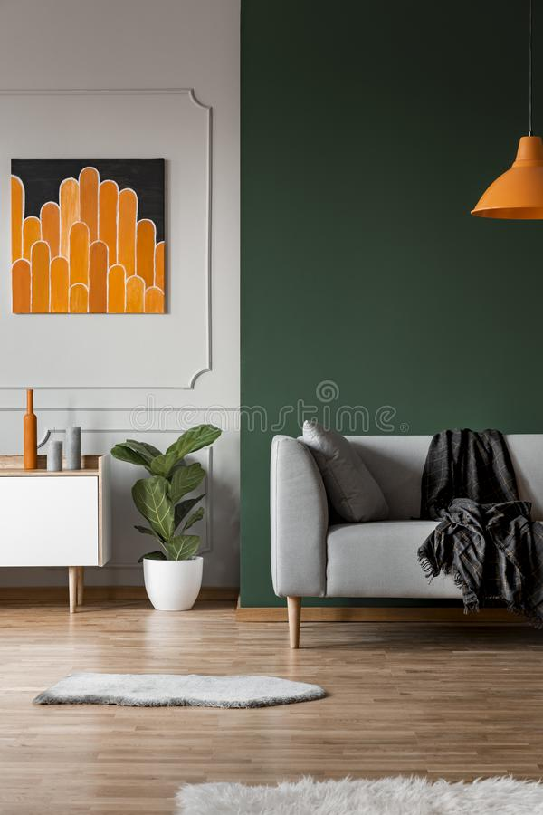 Dark green wall in grey and orange living room royalty free stock photography