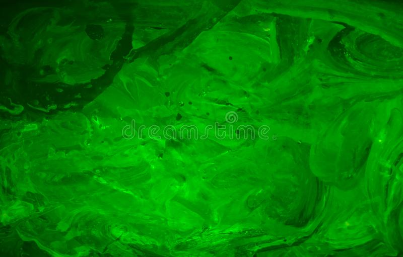 Dark green yellow liquid water acrylic stains. Modern and trendy oil gradients. Abstract textured background for wallpaper or stock photography