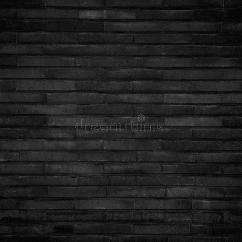 Dark grey black color brick wall background. Squared abstract image, copy space royalty free stock photos