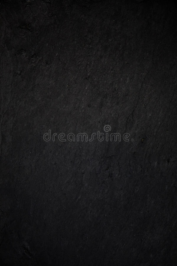 Dark grey black slate background or natural stone texture. stock photo