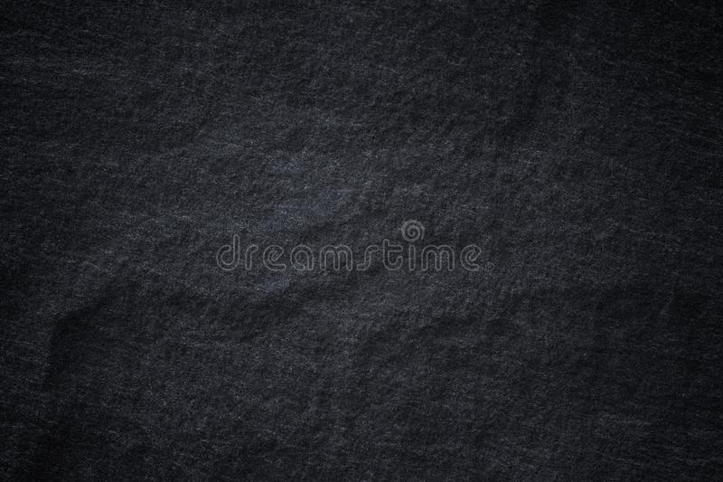 Dark grey black slate background or natural stone texture. Black stone wall royalty free stock photos