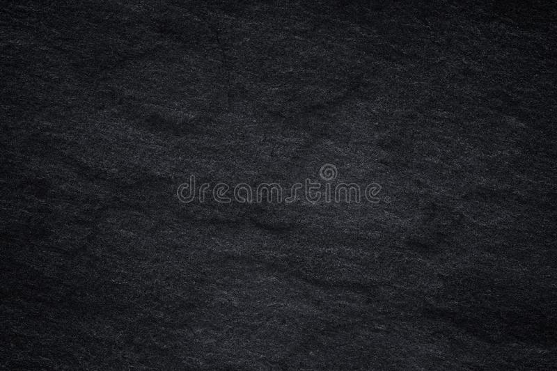 Dark grey black slate background or natural stone texture. Black stone wall stock illustration