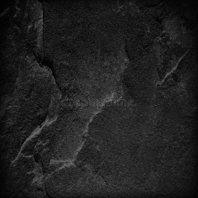 Dark grey black slate stone background or texture.  royalty free stock photography