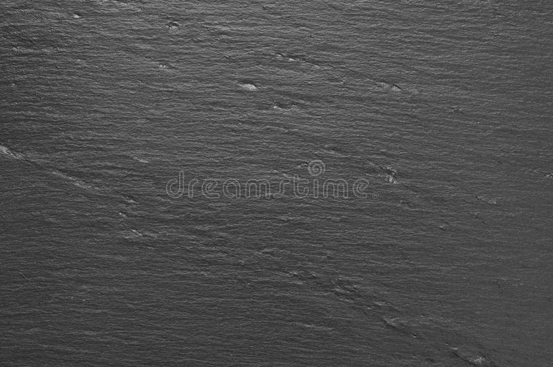 Black slate texture. Dark grey and black slate texture as background stock images